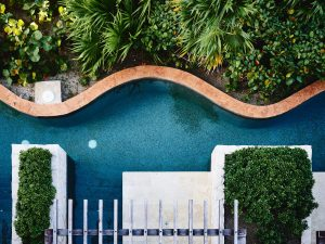 overhead view of backyard oasis with swimming pool
